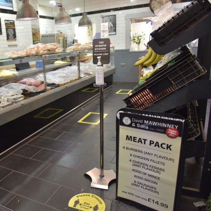 sanitiser station on display in butcher shop