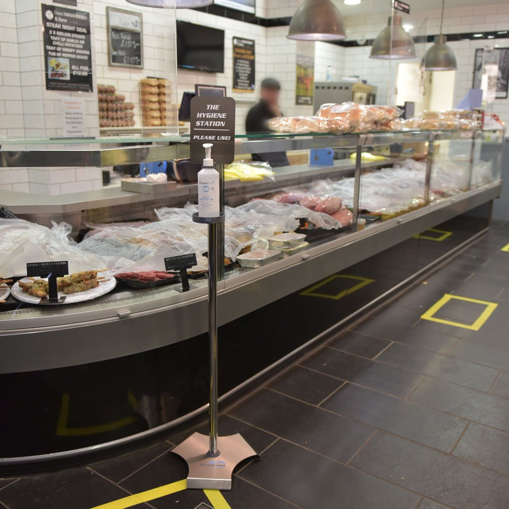 free-standing sanitiser stand on display in butchers